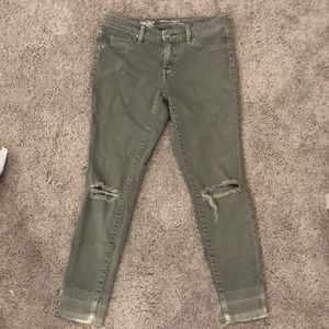 SOLD. army green skinny jeans